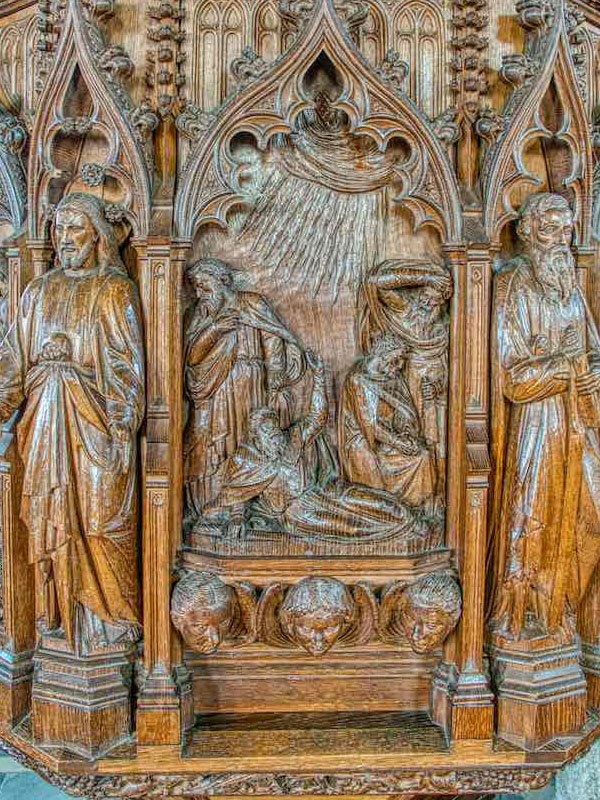 A wood pulpit carved by  Pinwill-Sisters, church of St Peter and St Paul