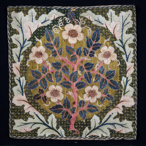 Rose Wreath was designed by William Morris and this example embroidered by May Morris