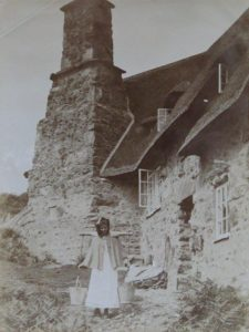 Girl collecting drinking water from the well at Stoneywell, early 20th century