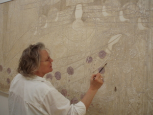 Jenny Vaughan working on a gesso panel