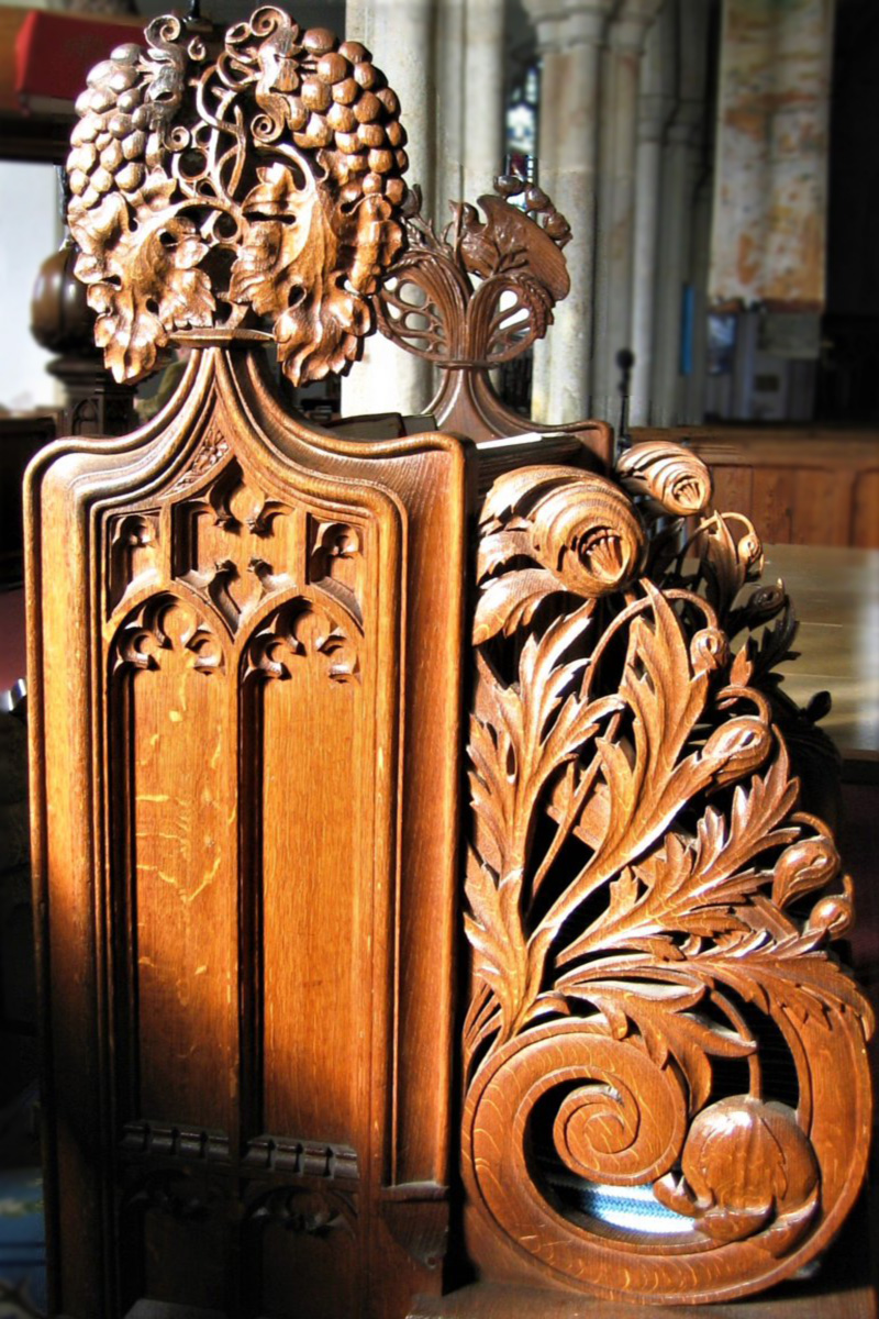 Choir stall bench end at Plympton St Mary, Devon carved by The Pinwill Sisters, 1898